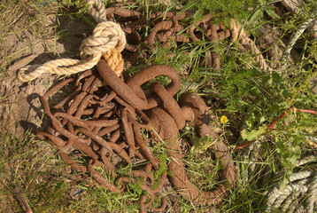 rusty fishermans chain & rope in grass