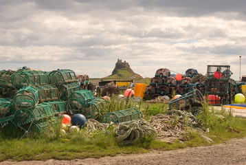 fishermans equipment at Lindisfarne with castle background