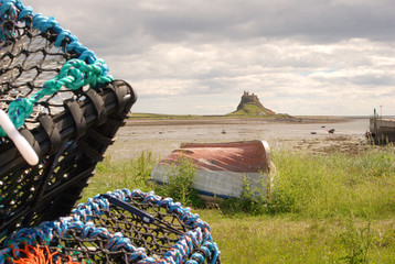 Harbour bay at Lindisfarne with castle & lobster pots