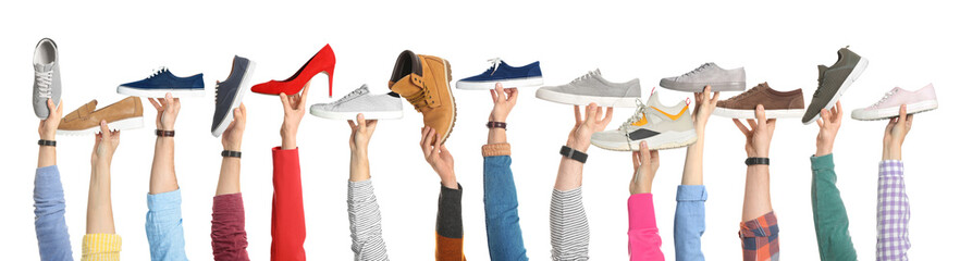 Wall Mural - Set of people holding different stylish shoes on white background, closeup