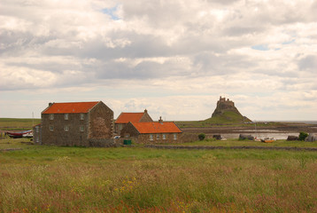 Lindisfarne castle, houses and shore
