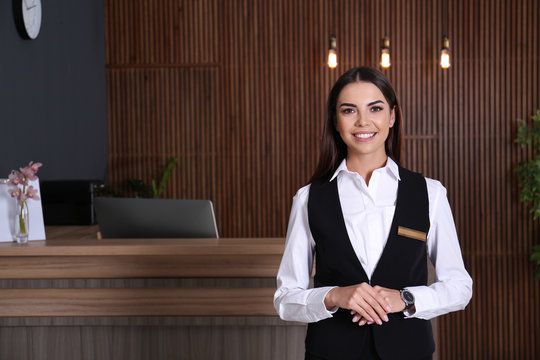 Portrait of receptionist at desk in lobby