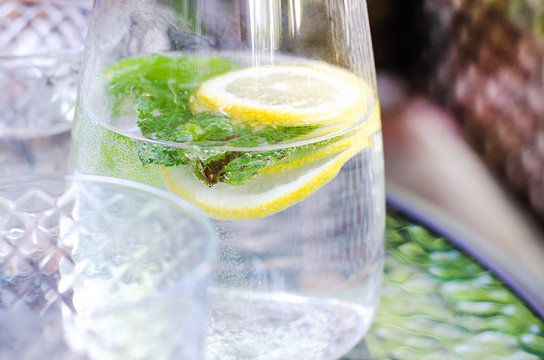 Simple water with lemon and mint in a jug.