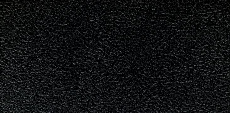 Black leather background. Panorama.