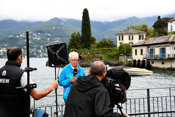 Media wait for the arrival of the Obama family to Villa Oleandra, the home of U.S. movie star George Clooney, in the northern Italian lakefront hamlet of Laglio