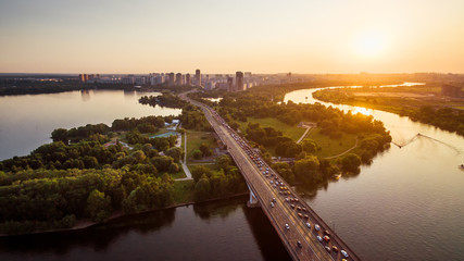 Fototapete - Panoramic view of Moscow at sunset, Russia. Scenery of Moskva River with bays in Moscow northwest. Beautiful landscape of Moscow in summer evening. Moscow skyline with Stroginsky Bridge in sun light.