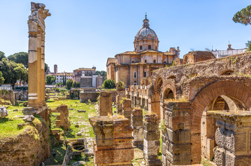Fototapete - Forum of Julius Caesar in summer, Rome, Italy. It is one of the main tourist attractions in Rome. Scenic view of Ancient Roman ruins in the Rome city center. Old famous architecture of Rome.