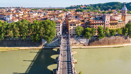 Fototapete - Bridge of Sant'Angelo in Rome, Italy. It is one of the top landmarks of Rome. Panoramic view of the Rome city from above. Embankment of Tiber River in summer. Cityscape of old Rome on sunny day.