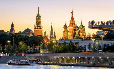 Wall Mural - Moscow Kremlin and St Basil`s Cathedral at sunset, Russia. Zaryadye Park on embankment of Moskva River. Evening view of the Moscow landmarks. Beautiful panorama of the Moscow city center at night.