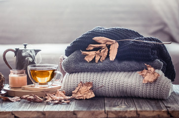 Cozy autumn still life with a cup of tea Wall mural
