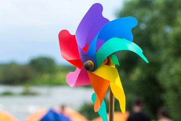 A child's pinwheel against a blue sky. Shot outside with studio lighting