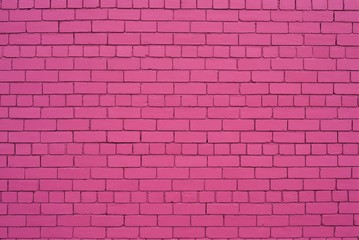 brick wall painted in shade of pink color.