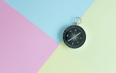 Compass on the colourful background for travel concept