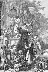 Holy Mary celebration as queen of May: a nun with the help of little girls and boys decorates a small chapel with flower festoons and a crown