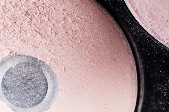 Cell with makeup shadows close-up, macro. Eye shadow dark and light shades.
