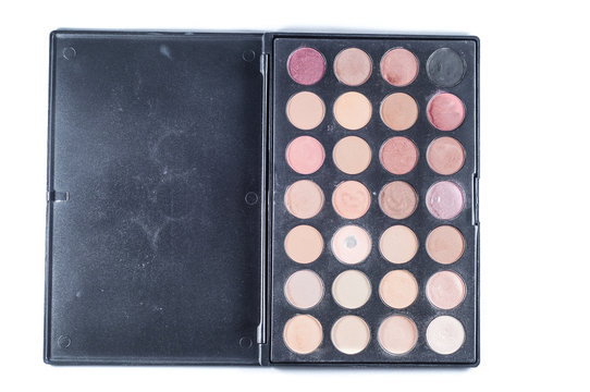 Palette with different shades of face shadows and brush applicator for application. Set for makeup on a white background, isolate.