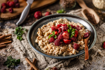 Homemade porridge with forest berries