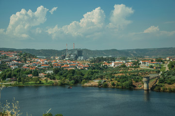 Wide Tejo River with pulp and paper industrial plant