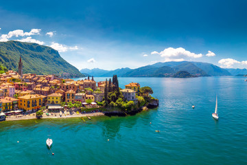 Foto auf AluDibond Himmelblau Aerial view of Varena old town on Lake Como with the mountains in the background, Italy, Europe