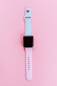 Watchband. Silicone strap for sports watches. Color bracelet for smart watches on pink background