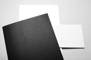 Blank Letterheads and Envelope over Black Folder