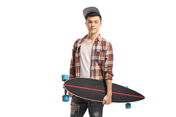 Young guy posing with a longboard