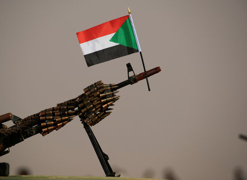 A Sudanese national flag is attached to a machine gun of Paramilitary Rapid Support Forces (RSF) soldiers as they wait for the arrival of Lieutenant General Mohamed Hamdan Dagalo before a meeting