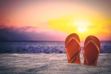 Stylish flip flops on beach