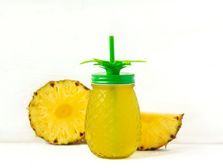 Pineapple juice and slices of fresh pineapple