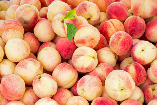 White peaches at an outdoor market