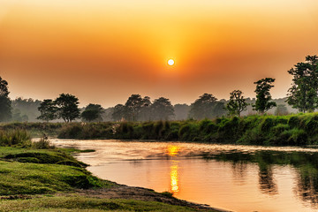 Sunset over the river in Chitwan National Park, Nepal