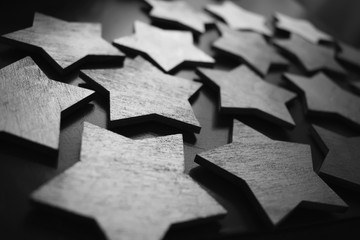 Wooden stars on the table. The texture of the stars. Black and white photo with stars