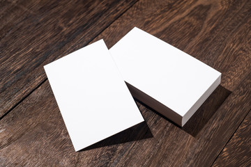 perspective view of white business card on wood floor