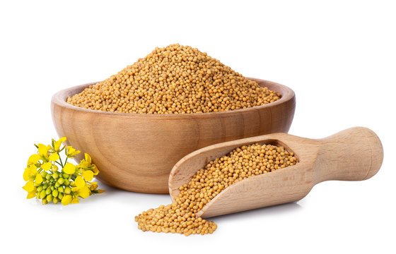 mustard seeds in wooden bowl