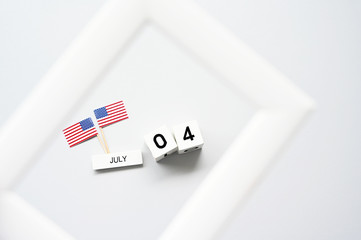 4th of July calendar and American Flag in picture frame Concept Happy Independence Day