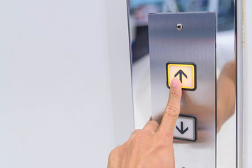 The man push lift button up