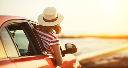 happy woman girl goes to summer travel trip in   car. Fototapete