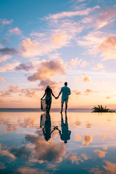 couple walking on the beach during summer vacation on a sunny day, men and woman on vacation at the tropical Island of Saint Lucia Caribbean