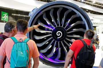 People look at a CFM LEAP engine at the 53rd International Paris Air Show at Le Bourget Airport near Paris