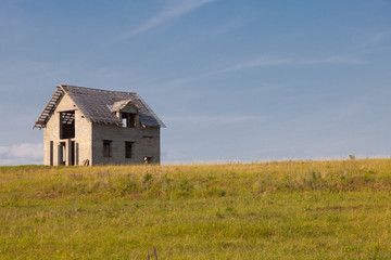 lonely unfinished house in the field