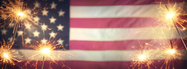 Vintage Celebration With Sparklers And Defocused American Flag - 4th Of July