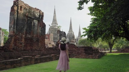 Wall Mural - Tourists visit and take a photo at Wat Phra Si Sanphet in Ayutthaya province, Thailand.
