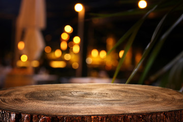 background of wooden table in front of abstract blurred restaurant lights Wall mural