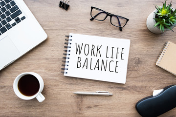 Wall Mural - Notebook with work life balance text on it. Top view, flat lay.