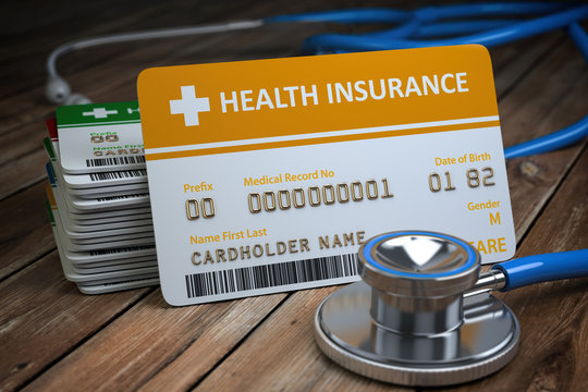 Health care medical Insurance card  and stethoscope as a symbol of  medicine on the wood background.