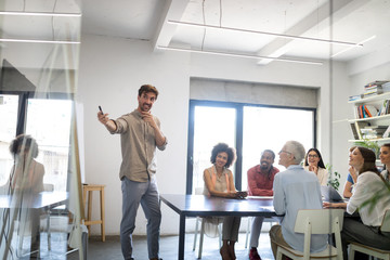 Group of successful business people at work in office