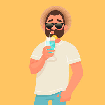 Concept of relaxation and summer vacation. A man in sunglasses is drinking a cocktail. Rest by the sea