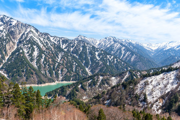 Snow mountain range and Kurobe lake at Tateyama Kurobe Alpine Route.