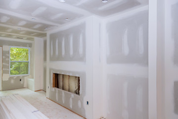 Interior construction of housing drywall installed and patched without painting applied