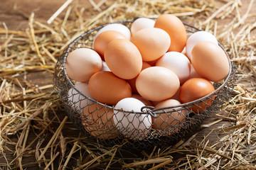 basket of colorful fresh eggs